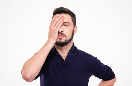 Photo for Close up portrait of disappointed stressed bearded young man in sweetshirt with closed eyes over white background - Royalty Free Image