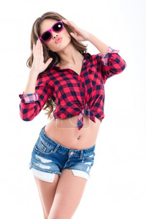 Amusing pretty young woman in checkered shirt, jea...