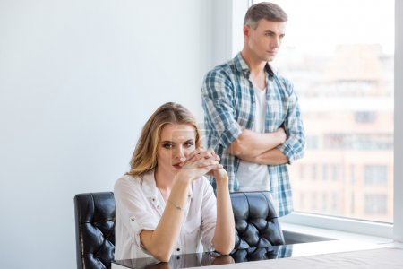 Unhappy couple ignoring each other after argument