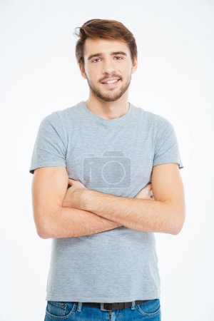 Photo for Happy casual man standing with arms folded isolated on a white background - Royalty Free Image