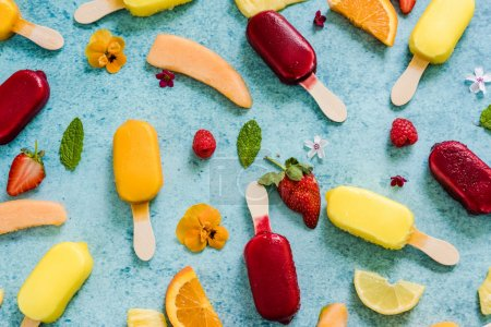 Photo for Refreshing homemade popsicle from above on slate background with space for text - Royalty Free Image