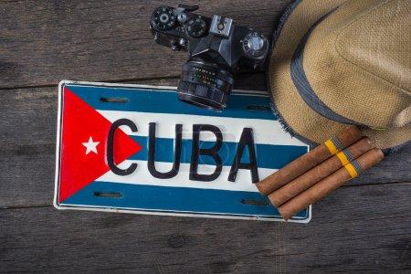 Retro camera and Cuban flag and cigars
