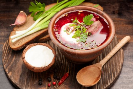 Borsch on the old wooden background