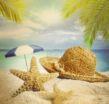 Photo for Sandy beach, straw hat and starfish in summer - Royalty Free Image