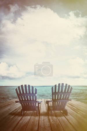 Photo for Blue adirondack chairs on dock with vintage textures and feel - Royalty Free Image