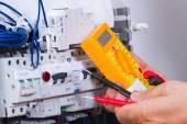 """Постер, картина, фотообои """"Male electrician working"""""""