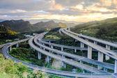 """Постер, картина, фотообои """"шоссе в ночь с автомобилями света в современном городе в Тайване, Азия"""""""