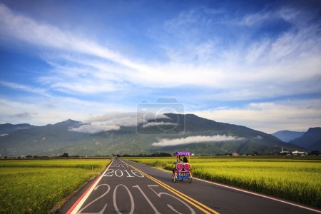 Driving on an road towards to upcoming 2016 and leaving behind o