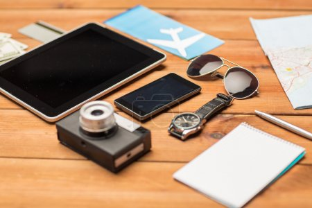 close up of smartphone and travel stuff