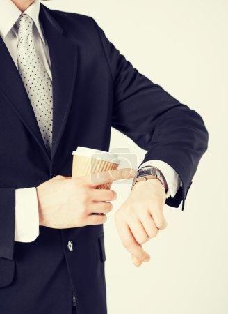 man looking at wristwatch