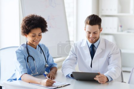 two happy doctors meeting at hospital office