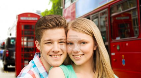 happy couple over london city street
