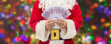 close up of santa claus with euro money