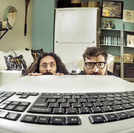 Two funny computer scientits staring at a keybord