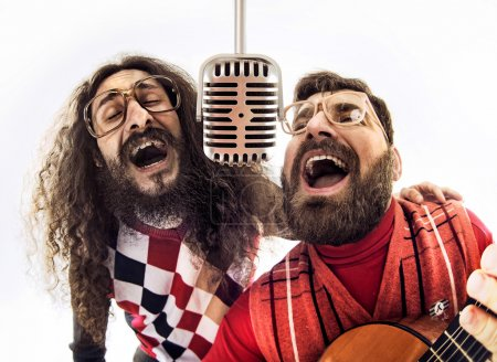 Two nerdy guys singing together