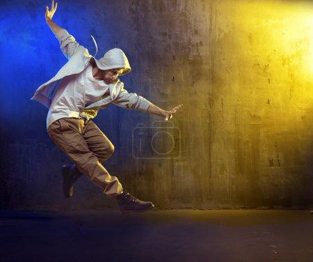 Athletic guy dancing a hip hop