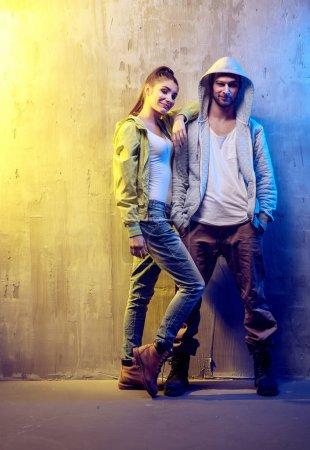 Portrait of two talented hip-hop dancers on a concrete backgroun