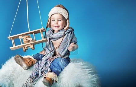 Portrait of a cheerful little pilot