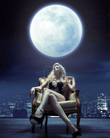 Sensual woman relaxing under the moon light