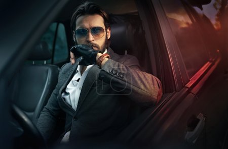 Photo for Handsome fashion man driving a car - Royalty Free Image