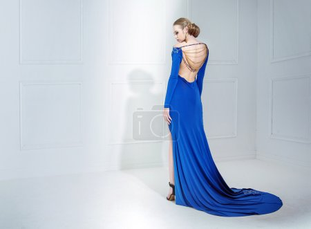 Elegant lady wearing a luxury blue gown