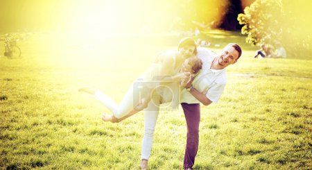 Photo for Portrait of a delighted family relaxing in the summer park - Royalty Free Image