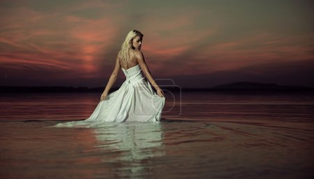 Photo for Sensual lady dancing in the lake - Royalty Free Image
