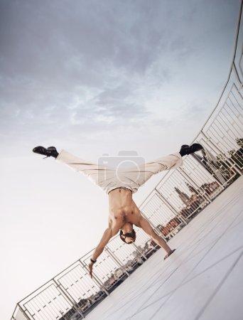 Muscular guy doing hard exercises
