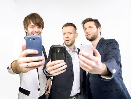 A few guys uisng their smart phones