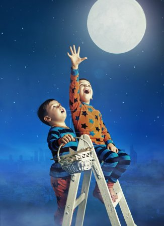 Two little brothers catching the huge moon...