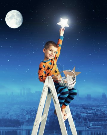 Little boy collecting shining stars