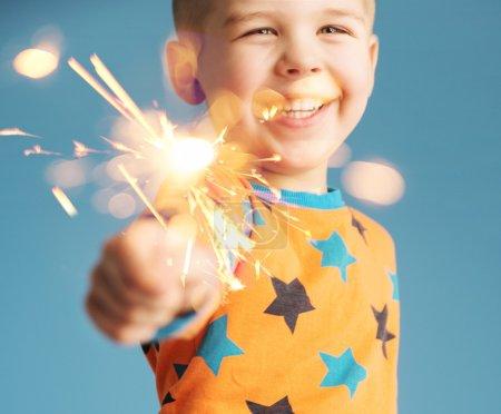 Little boy holding a sparkler
