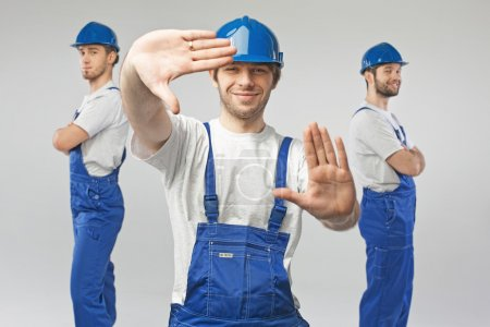 Three handsome and happy builders