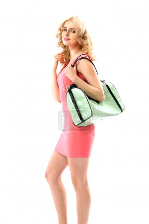 Photo for Blond beautie holding a trendy new handbag - Royalty Free Image