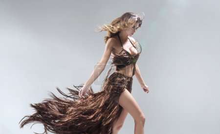 Photo for Conceptual portriat of the woman wearing gown made of hair - Royalty Free Image