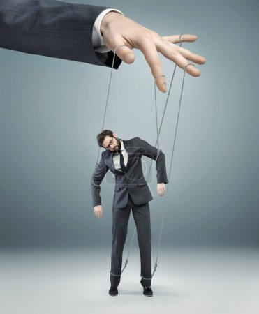 conceptual picture of a boss pulling the strings