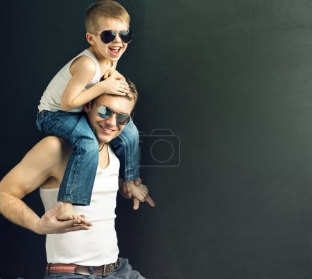 Photo for Young handsome guy posing with his son - Royalty Free Image