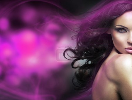 Conceptual picture of a brunette woman with a purple light