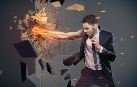Conceptual portrait of a businessman beating a barrier
