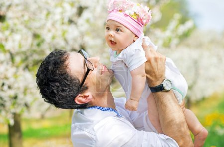 Photo for Happy father cuddling his cute baby - Royalty Free Image