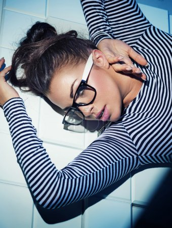 Pretty brunette woman with trendy glasses