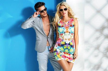 Glamour couple wearing trendy summer stuff