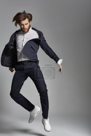 Photo for Portrait of the jumping flexible man - Royalty Free Image