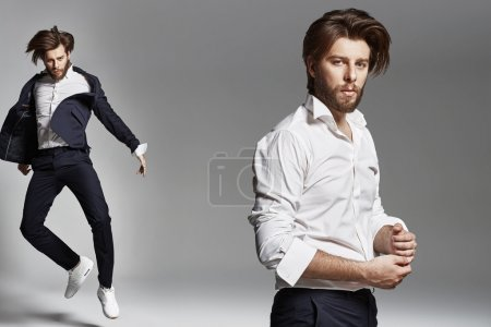 Photo for Jumping flexible man wearing suit - Royalty Free Image