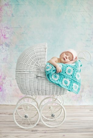 Cute child sleeping in the pram