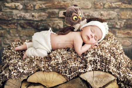 Photo for Newborn kid sleeping on the wooden bed - Royalty Free Image