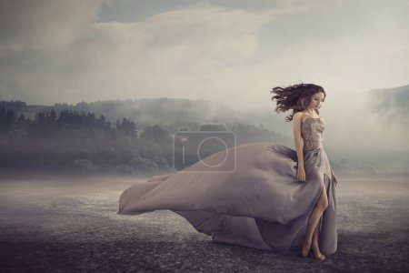 Sensual woman walking on the fantasy ground
