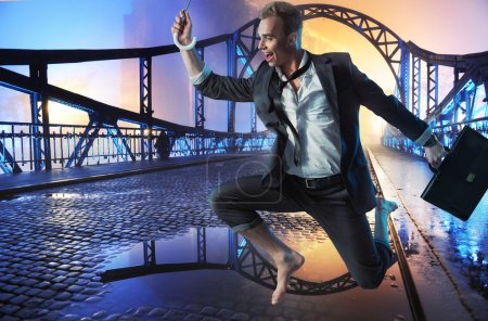 Successful businessman jumping on the bridge