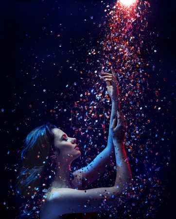 Photo pour Portrait of a brunette lady taking a sequin shower - image libre de droit