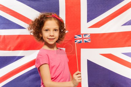 girl with flag in front of British  flag